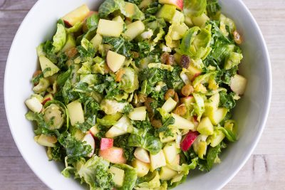 Kale and Brussels Sprout Salad with Nutritional Yeast Vinaigrette - The Foodie Eats