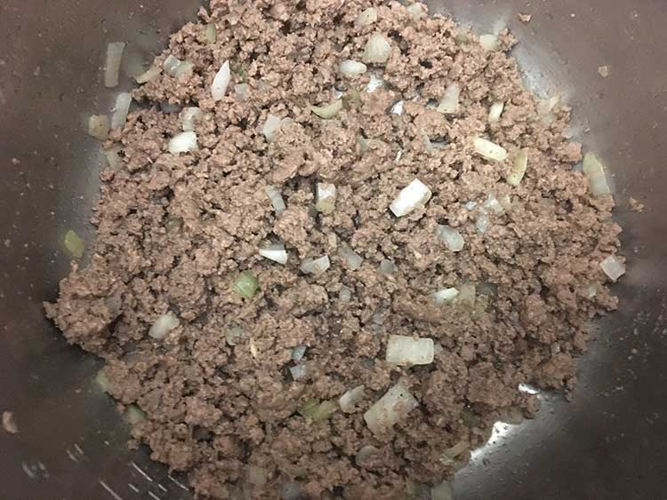 Browned ground beef and diced onions in Instant Pot.