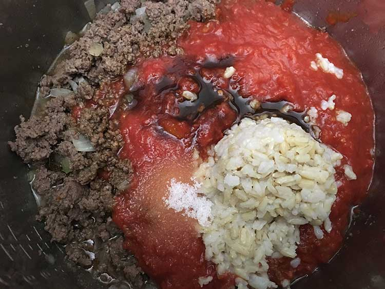 Browned beef topped with crushed tomatoes, rice, and Worcestershire.