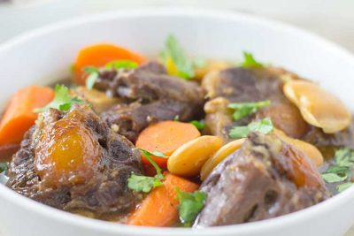 Pressure Cooker Oxtail Stew - Close-up in white bowl   The Foodie Eats