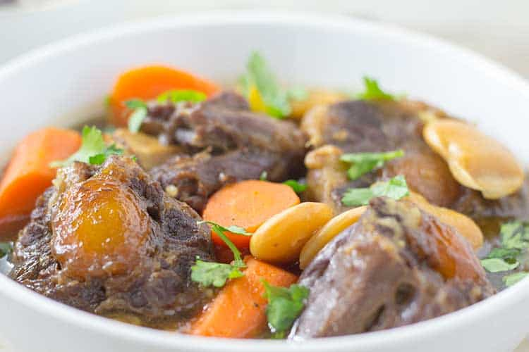 Pressure Cooker Oxtail Stew - Close-up in white bowl | The Foodie Eats