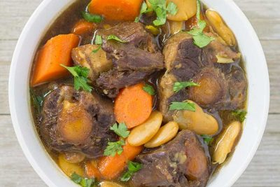Pressure Cooker Oxtail Stew - overhead in white bowl | The Foodie Eats