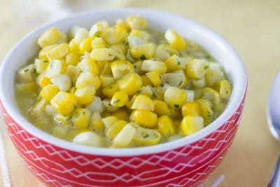 Instant Pot Creamed Corn in small red bowl.