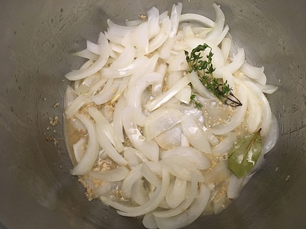 Sautéed onions with thyme, garlic, and bay leaf.