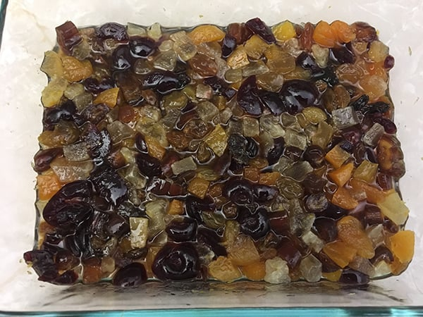 dried fruits soaking in Fireball whiskey in Pyrex dish