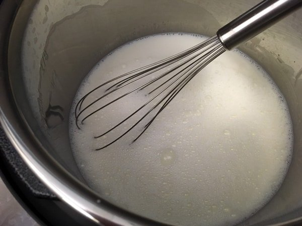 sugar and milk with whisk