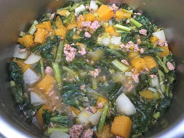sautéed turnip greens, butternut squash, turnip roots, and Italian sausage in chicken broth