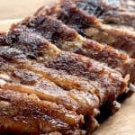 dry-rubbed ribs on wood cutting board