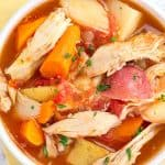 chicken stew in white bowl with yellow napkin