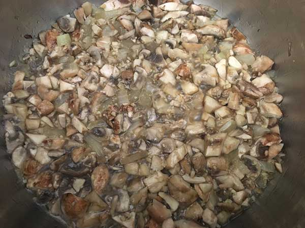 chopped mushrooms sautéing with minced garlic