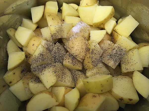 chopped gold potatoes topped with salt and pepper