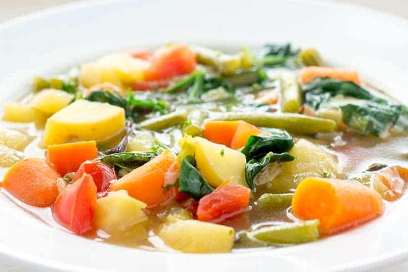 Vegetable soup in white bowl