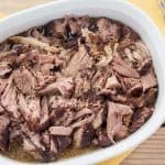 Pulled pork in white bowl.