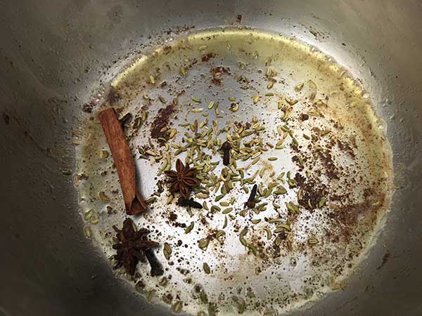 Toasting spices in bottom of Instant Pot.