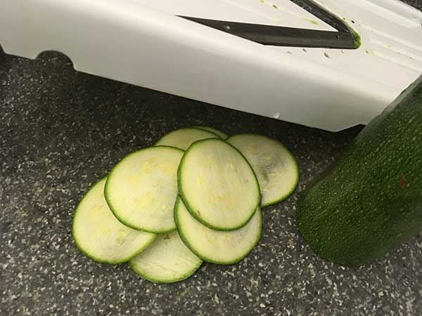mandoline with sliced zucchini