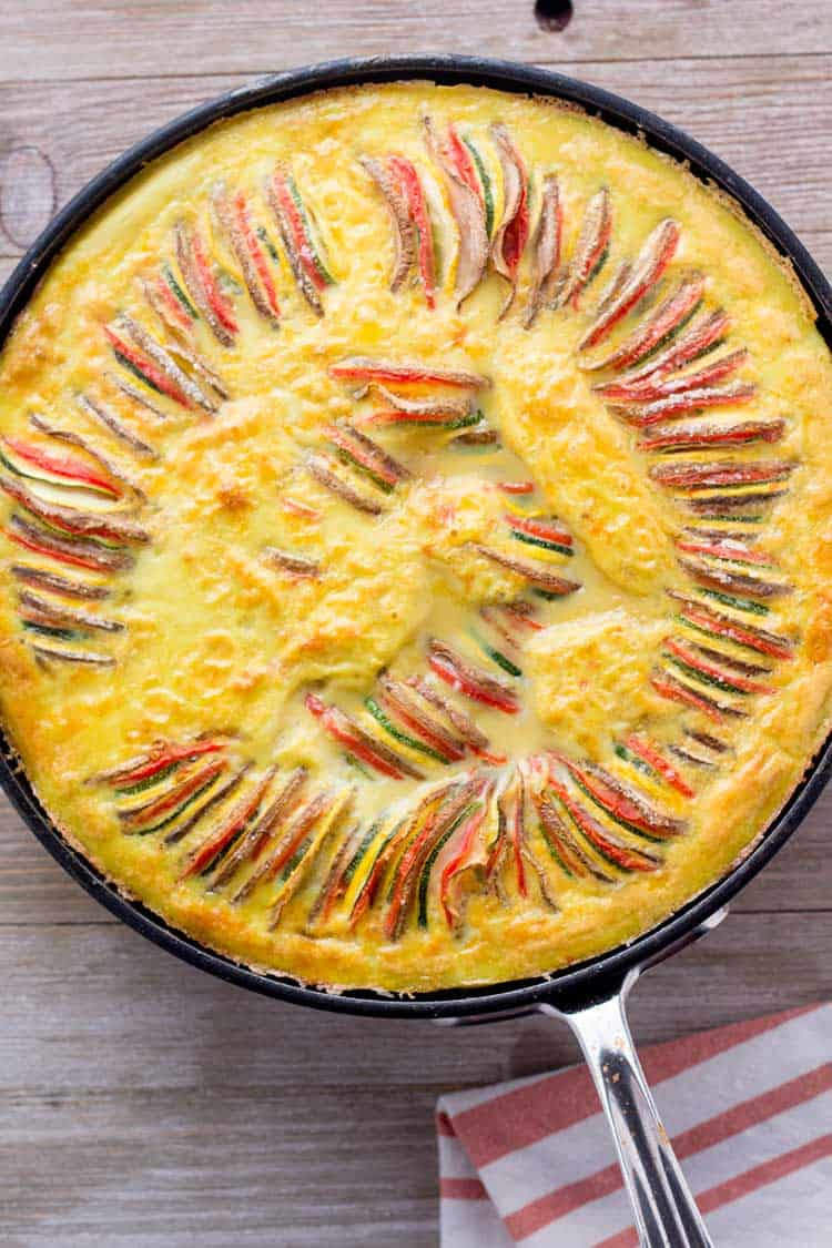 ratatouille frittata in pan on wood board