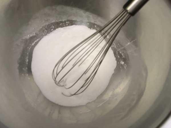 sugar and cornstarch in mixing bowl with whisk.