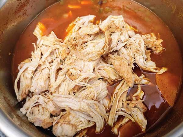 Shredded chicken on top of chili.