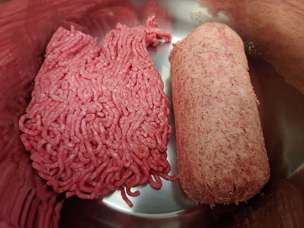 Uncooked beef and sausage.