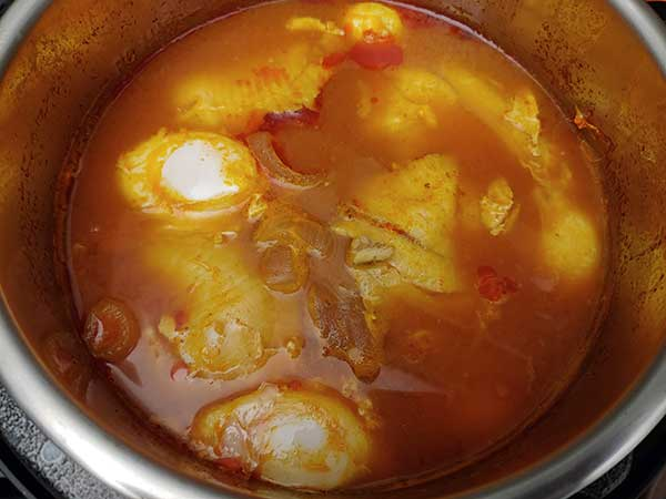 Poached eggs in top of fish stew in Instant Pot.