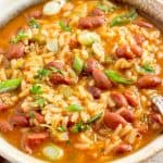 Red beans and rice in bowl with spoon.