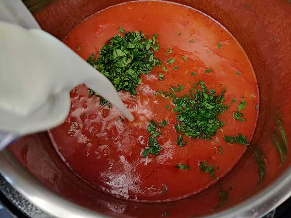 Pouring buttermilk into soup.