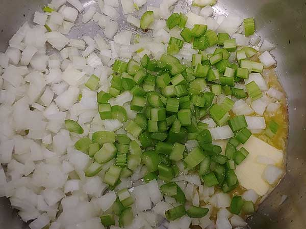 Melted butter in pot with diced onions and celery.