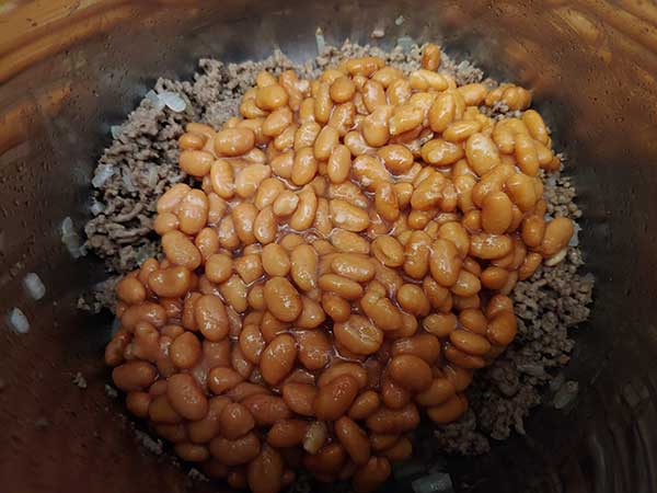 Pinto beans on top of ground beef.