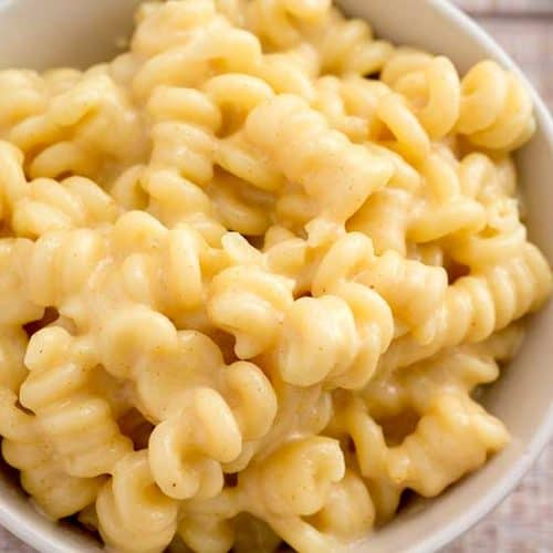 Truffled mac and cheese in white bowl.