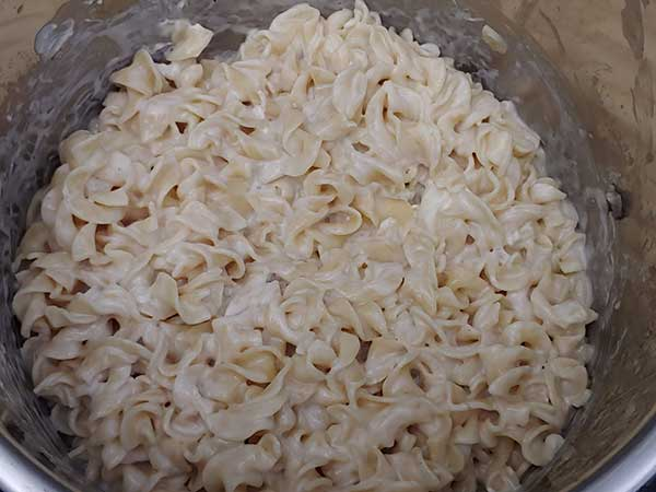 Egg noodles mixed with melted cream cheese.