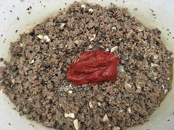 Ground beef and mushroom mixture topped with tomato paste.