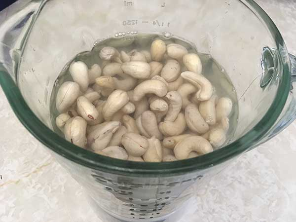 Raw cashews and warm water in blender.