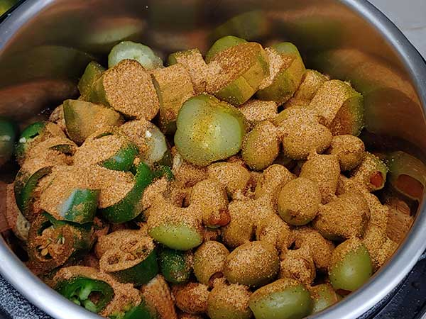 Pickles, jalapenos, and olives on top of peanuts seasoned with creole spices.