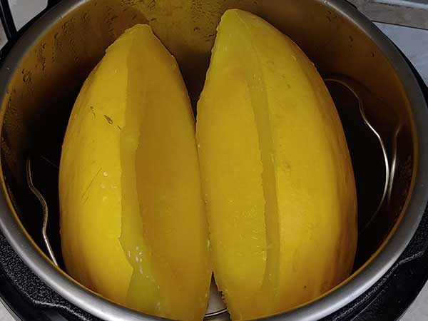 Cooked spaghetti squash halves in Instant Pot.