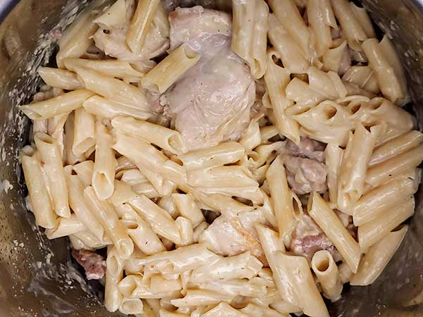 Chicken and penne pasta in creamy sauce.
