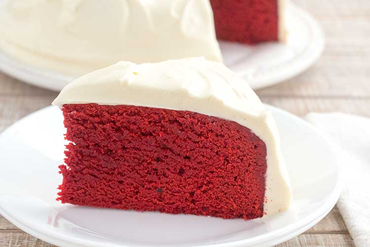 Slice of Instant Pot red velvet cake on white plate.