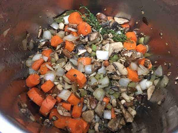 Vegetables sautéing in pot