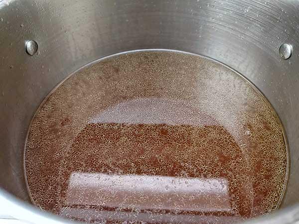 Pho broth in pot.