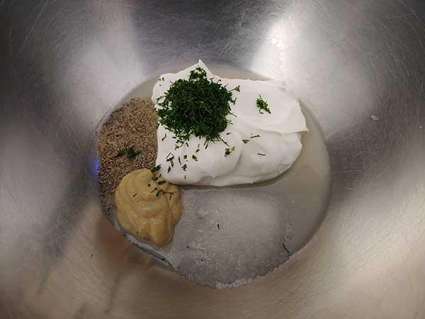 Vegan mayo, dill, Dijon, lemon juice, salt and pepper in bowl.