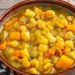 Instant Pot chickpea stew in brown bowl.