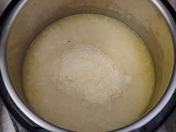 Cooked rice in chicken broth topped with Parmesan cheese.