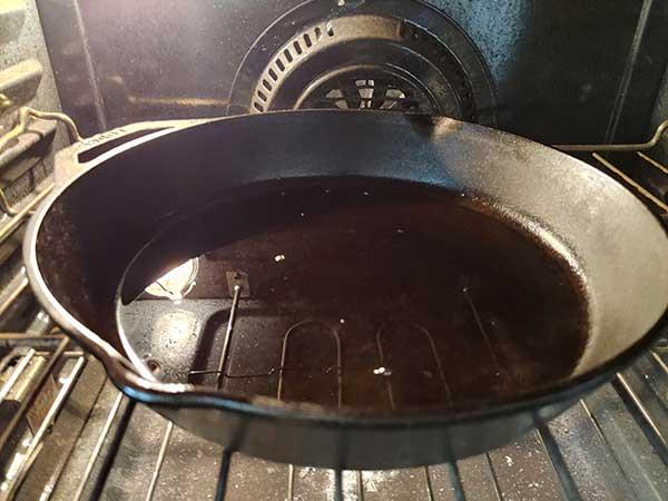 Cast iron skillet inside oven.
