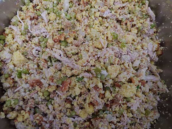 Cornbread and stuffing mixed with turkey and vegetables.